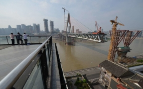 Construction of a bridge in Chongqing in 2012. The Xiaonanhai Dam would have been city's largest infrastructure project.